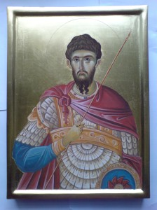 gilded orthodox icon showing saint theodore the recruit in armour and holding a spear and sheild
